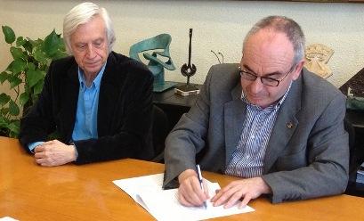 Portas i Marigó durant la firma del conveni